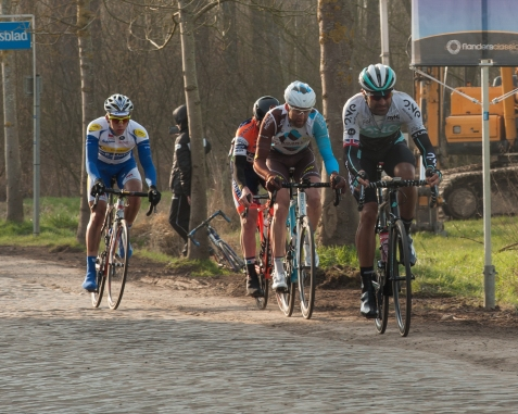 A day at the race: Omloop Het Nieuwsblad: on the pave at Paddestraat. Kristian on the cobbles.