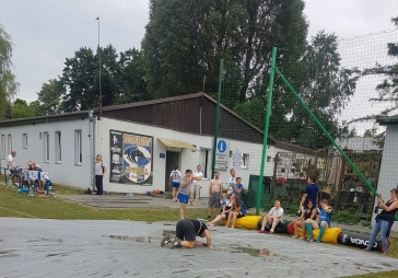 Relaxing at the Juvenia Rugby Club, Kraków. Wet slide.