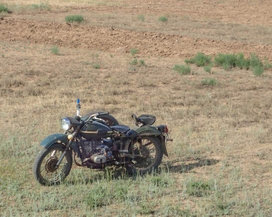 Motorbike and sidecar - abandoned or used by a local herdsman?