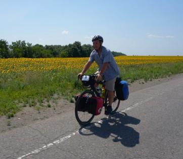 Keith riding the Ukraine farmfields with Sunflowers