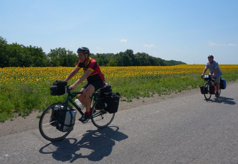 Dale and Keith pass sunflowers on the Ukraine steppes
