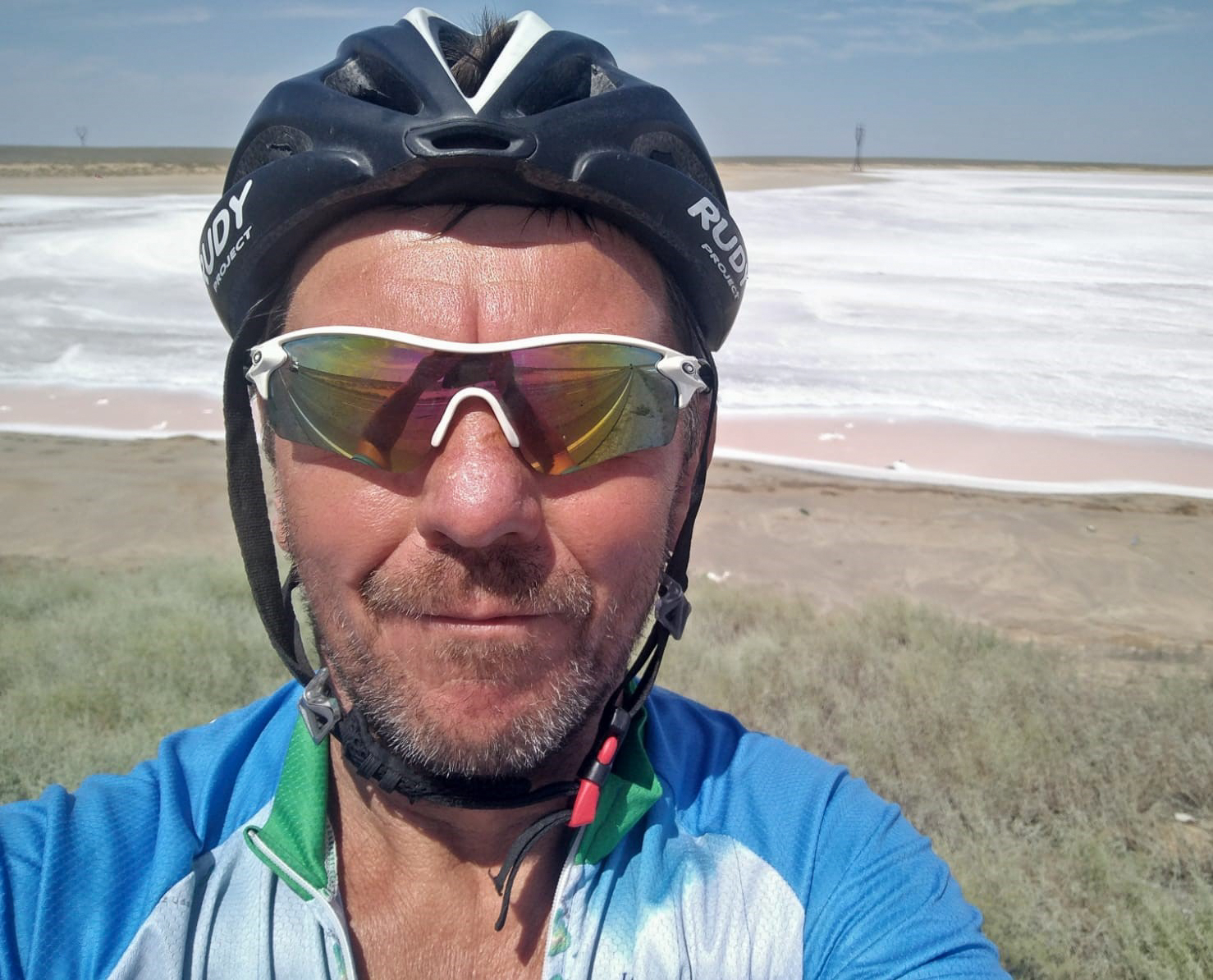 Keith with a dried up salt-pan behind