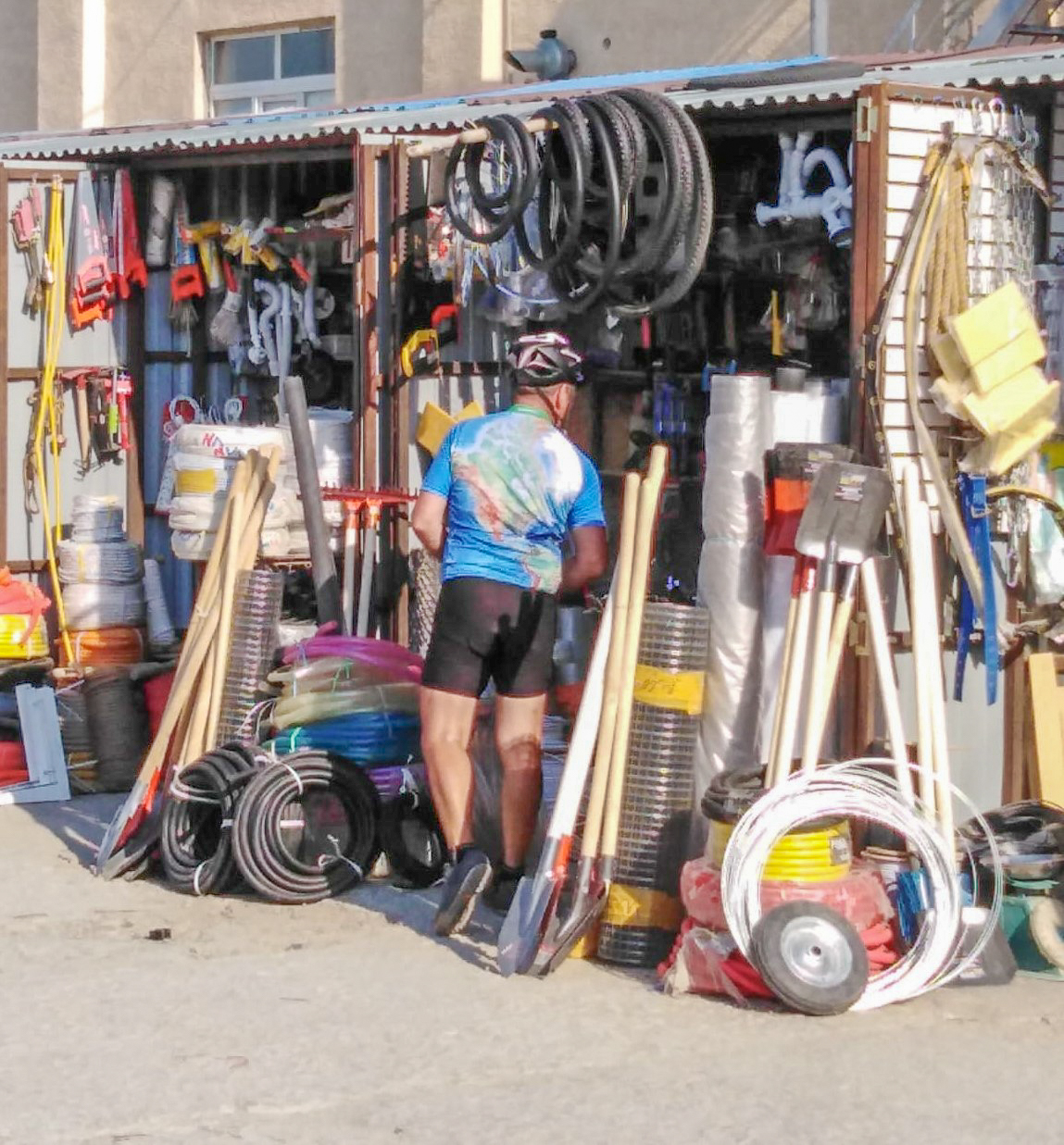 Keith buying tyres and inner tubes at the local market