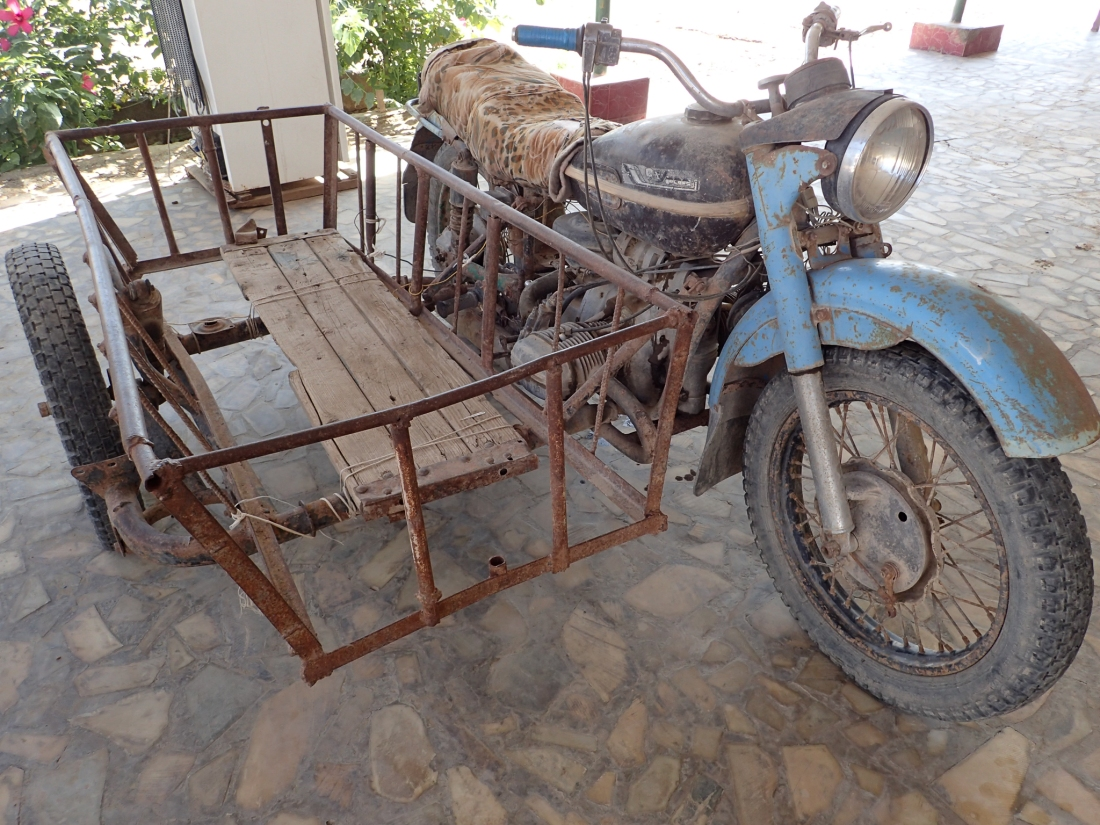 Ancient motorbike and sidecar