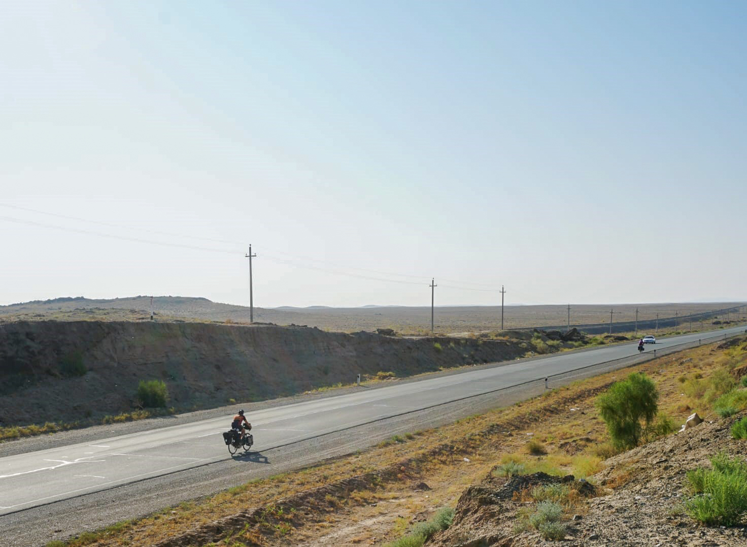Riding a long lonely road through the desert