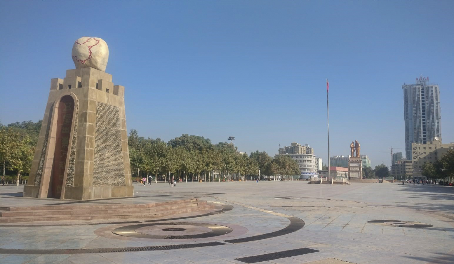 In Hotan. Interesting map of China on the monument.