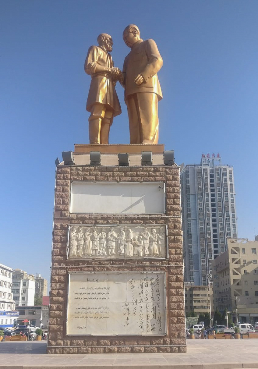 In Hotan. Chairman Mao, but who's he with?