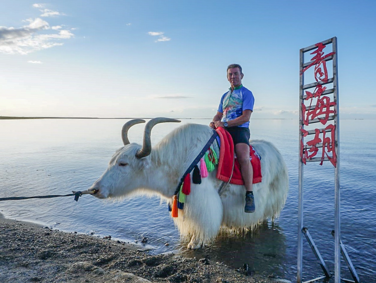 Keith, riding a yak in a lake