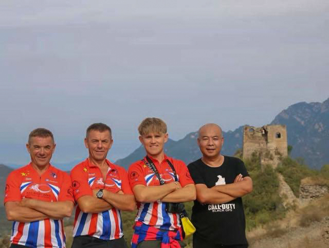 At the Great Wall of China. Dale, Keith, Linford and the photographer!