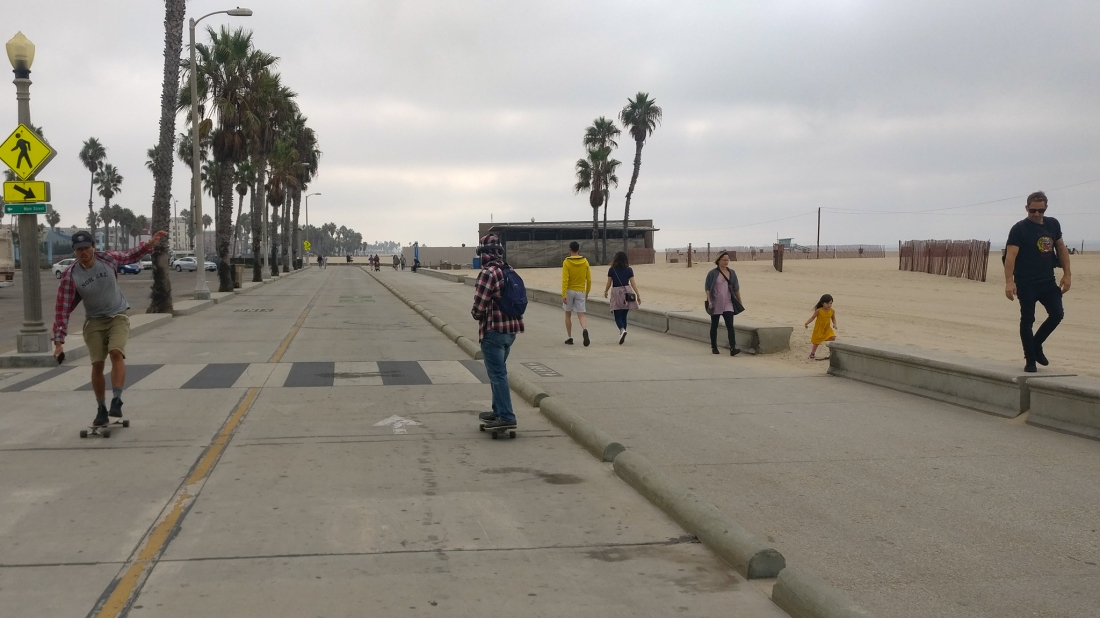 beach cycle path with skateboarders