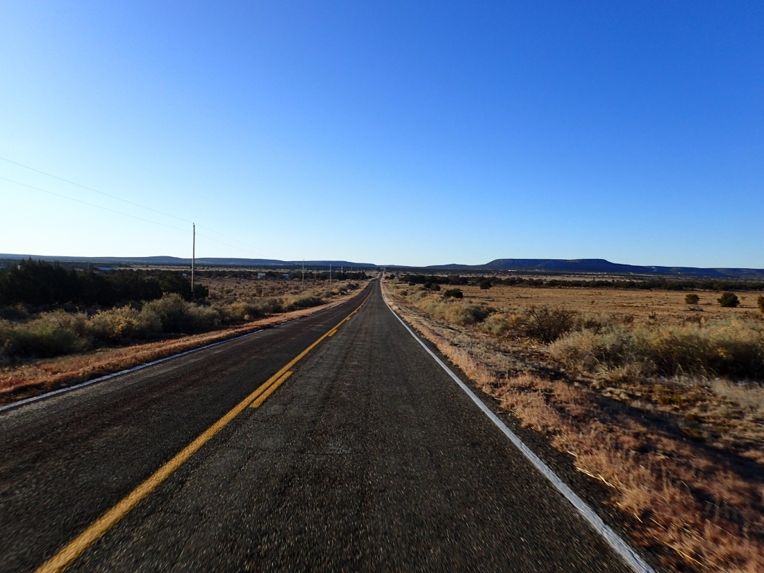 A long straight road through the praire
